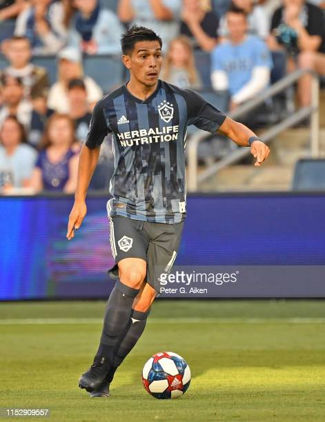 Favio Alvarez of Los Angeles Galaxy dribbles the ball up field during the first half against Sporting Kansas City on May 29 2019 at Children's Mercy...