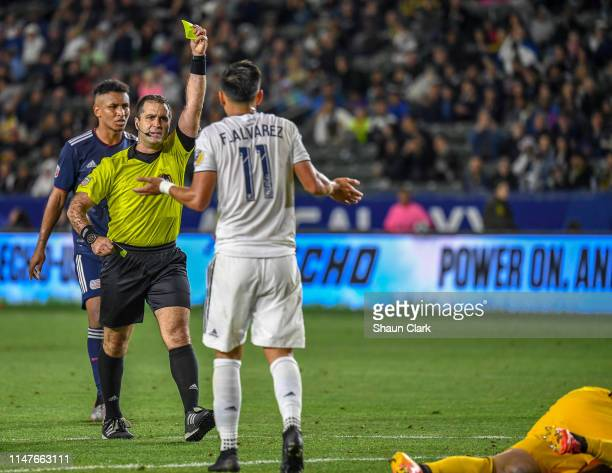 Favio Alvarez of Los Angeles Galaxy gets a yellow card during the Los Angeles Galaxy's MLS match against New England Revolution at the Dignity Health...