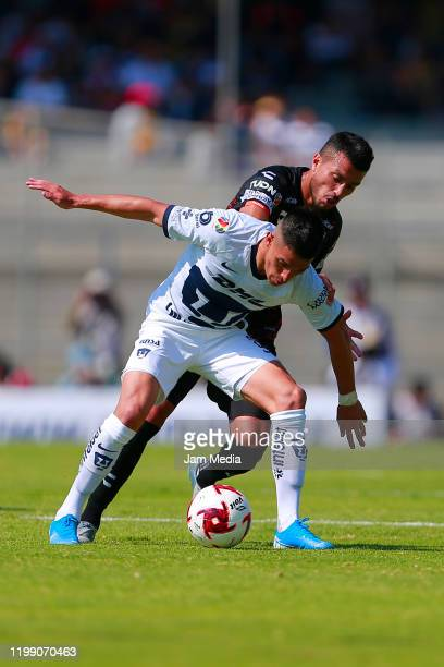Favio Alvarez of Pumas controls the ball during the 1st round match between Pumas UNAM and Pachuca as part of the Torneo Clausura 2020 Liga MX at...
