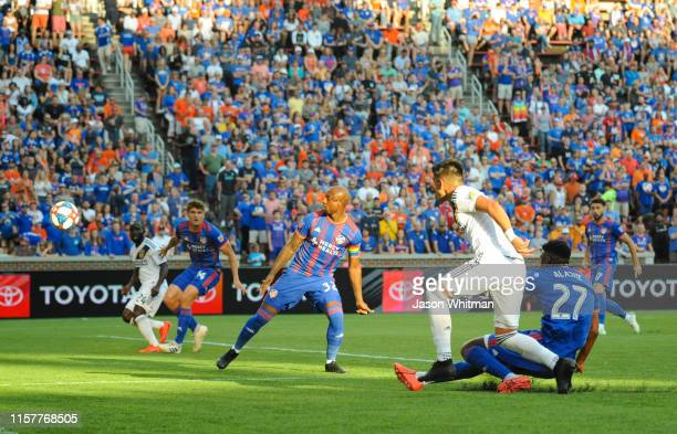 Favio Alvarez of the LA Galaxy takes a shot on goal during the first half of their match against FC Cincinnati at Nippert Stadium on June 22 2019 in...