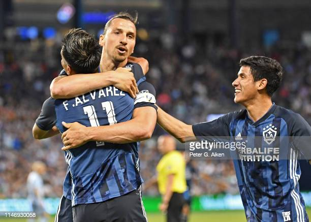Favio Alvarez of the Los Angeles Galaxy celebrates after scoring a goal with Zlatan Ibrahimovic during the second half against Sporting Kansas City...