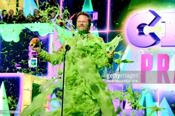 Favorite buttkicker winner for 'Jurassic World Fallen Kingdom' actor Chris Pratt gets slimed on stage during the 32nd Annual Nickelodeon's 2019 Kids'...