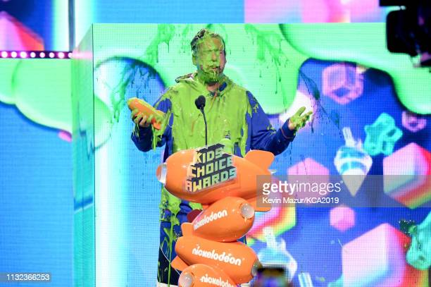Favorite male voice from an animated movie winner for 'Hotel Transylvania 3' actor Adam Sandler gets slimed on stage during the 32nd Annual...