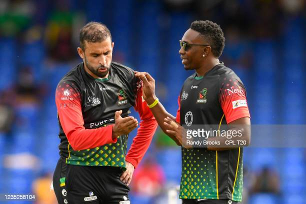 Fawad Ahmed and Dwayne Bravo of Saint Kitts & Nevis Patriots during the 2021 Hero Caribbean Premier League Play-Off match 32 between Guyana Amazon...