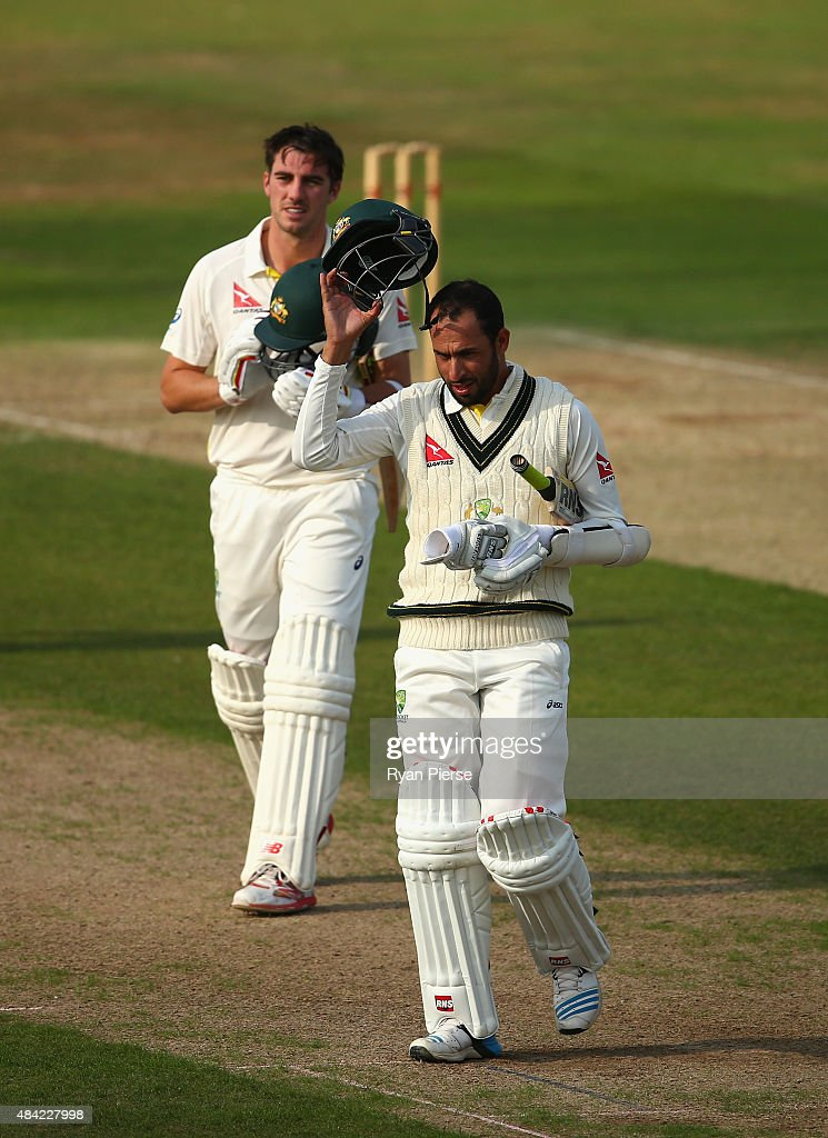 Fawad Ahmed of Australia and Pat Cummins of Australia leave the ground after the match was drawn during day three of the tour match between Northamptonshire and Australia at The County Ground on August 16, 2015 in Northampton, England.