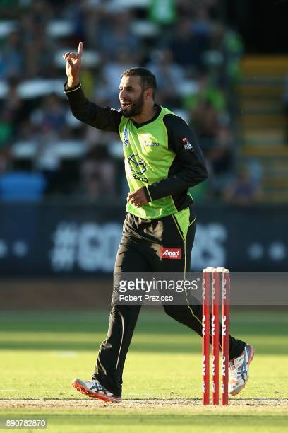 Fawad Ahmed of Sydney Thunder celebrates after taking the wicket of James Faulkner of the Melbourne Stars during the Big Bash League exhibition match...