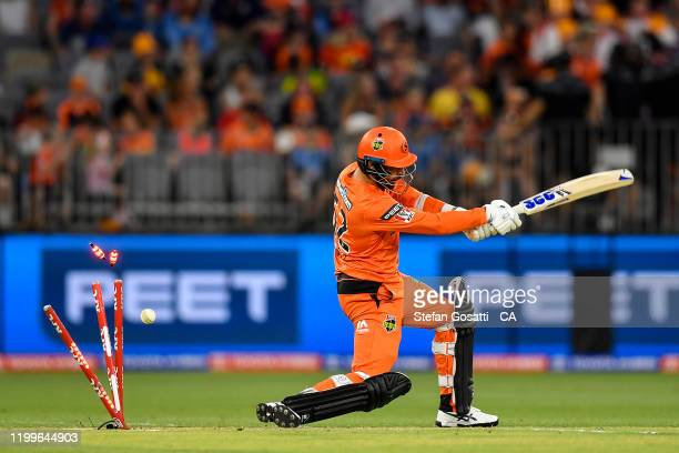 Fawad Ahmed of the Scorchers is bowled by Haris Rauf of the Stars during the Big Bash League match between the Perth Scorchers and the Melbourne...