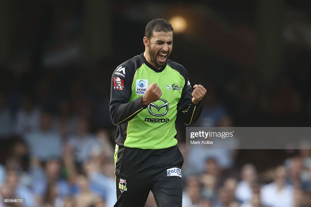 Fawad Ahmed of the Thunder celebrates taking the wicket of Moises Henriques of the Sixers during the Big Bash League match between the Sydney Sixers and the Sydney Thunder at Sydney Cricket Ground on January 14, 2017 in Sydney, Australia.