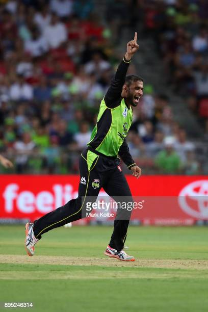 Fawad Ahmed of the Thunder celebrates taking the wicket of Nic Maddinson of the Sixers during the Big Bash League match between the Sydney Thunder...