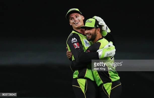 Fawad Ahmed of the Thunder celebrates with Jay Lenton of the Thunder after taking a catch to dismiss Will Bosisto of the Scorchers during the Big...