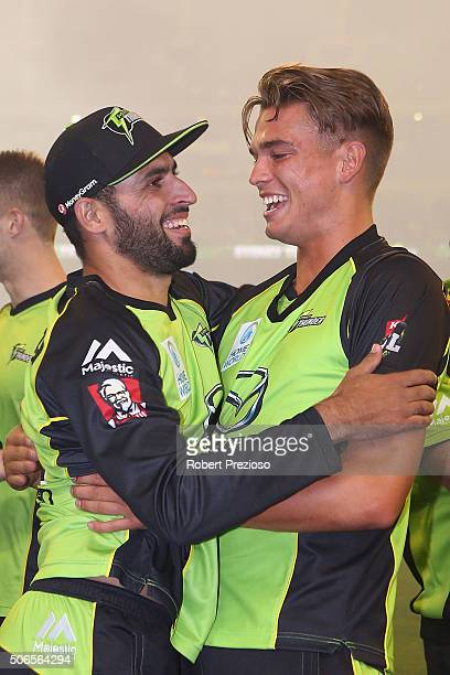 Fawad Ahmed of the Thunder celebrates with teammate Chris Green of the Thunder after a win during the Big Bash League final match between Melbourne...