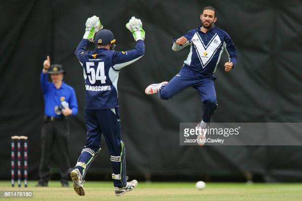 Fawad Ahmed of Victoria celebrates taking the wicket of Peter Nevill of NSW during the JLT One Day Cup match between New South Wales and Victoria at...