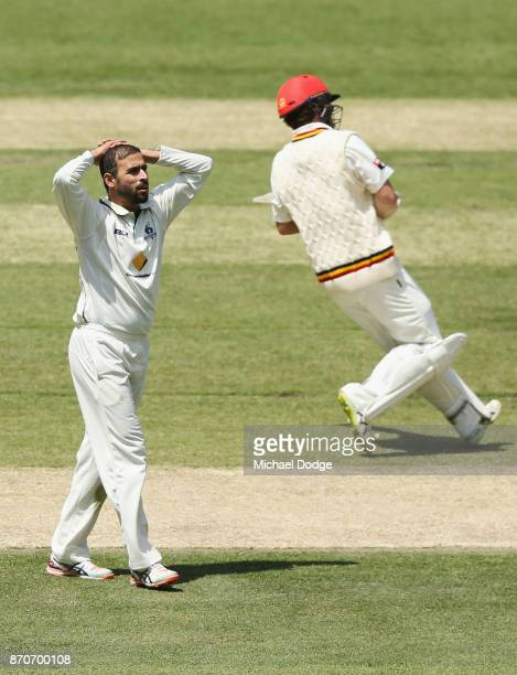 Fawad Ahmed of Victoria reacts after nearly capturing a wicket during day three of the Sheffield Shield match between Victoria and South Australia at...