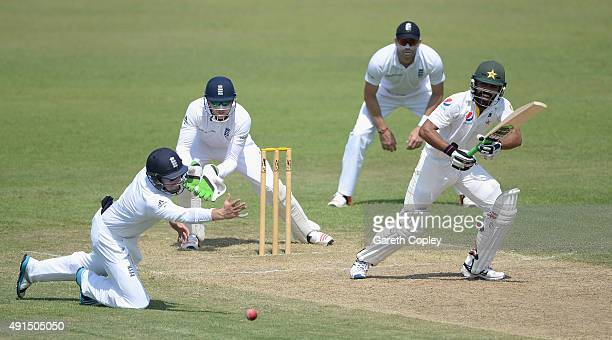 Fawad Alam of Pakistan A hits past Ian Bell of England during day two of the tour match between Pakistan A and England at Sharjah Cricket Stadium on...