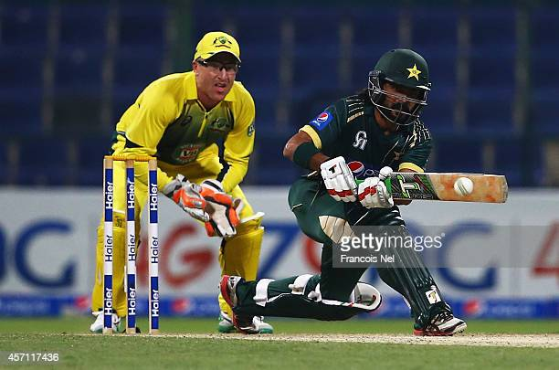 Fawad Alam of Pakistan bats as Brad Haddin of Australia looks on during the third match of the one day international series between Australia and...