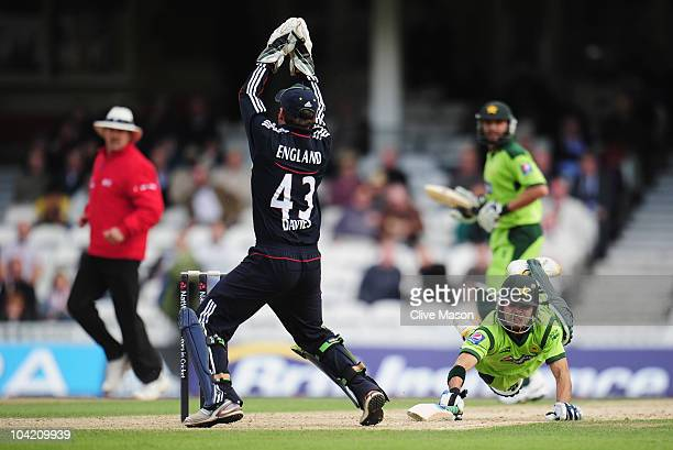 Fawad Alam of Pakistan dives to make his ground as Steven Davies of England takes the ball over the stumps during the 3rd NatWest One Day...