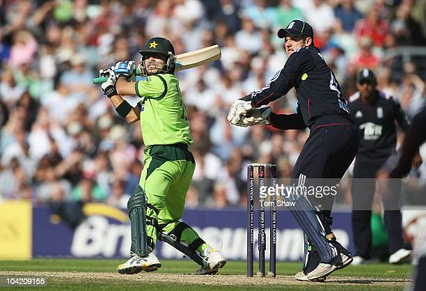 Fawad Alam of Pakistan hits out watched by Steven Davies of England during the 3rd NatWest One Day International between England and Pakistan at The...
