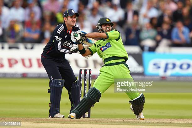 Fawad Alam of Pakistan hits out watched by Steven Davies of England during the 4th NatWest One Day International between England and Pakistan at...
