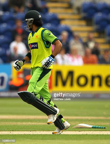 Fawad Alam of Pakistan parts company with his bat during the NatWest T20 International match between England and Pakistan at the Swalec Stadium on...