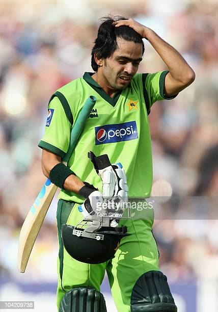 Fawad Alam of Pakistan walks back after being dismissed by Michael Yardy of England during the 3rd NatWest One Day International between England and...