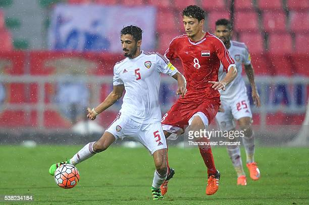 Fawaz Almessabi of United Arab Emirates and Fadi Saleh of Jordan competes for the ball during the 44th King's Cup match between the United Arab...