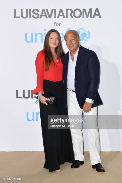 Fawaz Gruosi and a guest attend a photocall for the Unicef Summer Gala Presented by Luisaviaroma at Villa Violina on August 10 2018 in Porto Cervo...