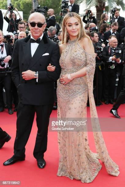 Fawaz Gruosi and Rita Ora attend the 70th Anniversary of the 70th annual Cannes Film Festival at Palais des Festivals on May 23 2017 in Cannes France