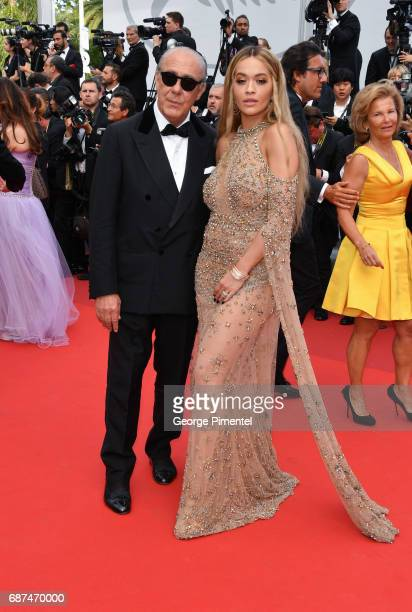 Fawaz Gruosi and Rita Ora attend the 70th Anniversary screening during the 70th annual Cannes Film Festival at Palais des Festivals on May 23 2017 in...