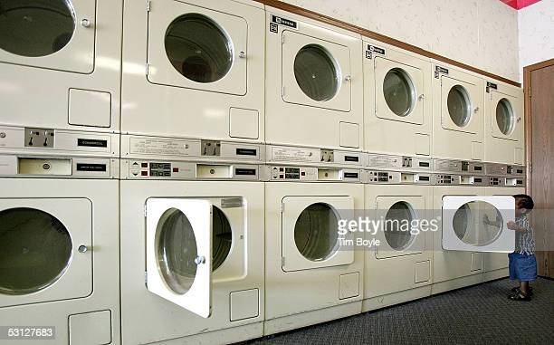Fawaz Ilumoka 21 months old plays near a bank of commercial Maytag dryers in a laundromat June 22 2005 in Glenview Illinois Chinese appliance maker...
