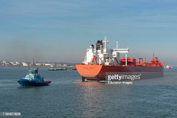 Fawley Southampton England UK 14 The Stena Sarita a crude oil tanker with tug Phoenix and stern line attached Maneuvering into a berth at Fawley oil...