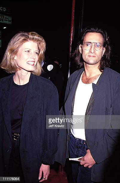 Fawn Hall and Doors manager Danny Sugerman during MTV Premiere of The Doors Sept 1991 at Whisky a Go Go in Hollywood California United States