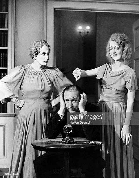 Fay Compton as Ruth Cecil Parker as Charles and Kay Hammond as Elvira in Noel Coward's comedy Blithe Spirit at the Piccadilly Theatre July 1941