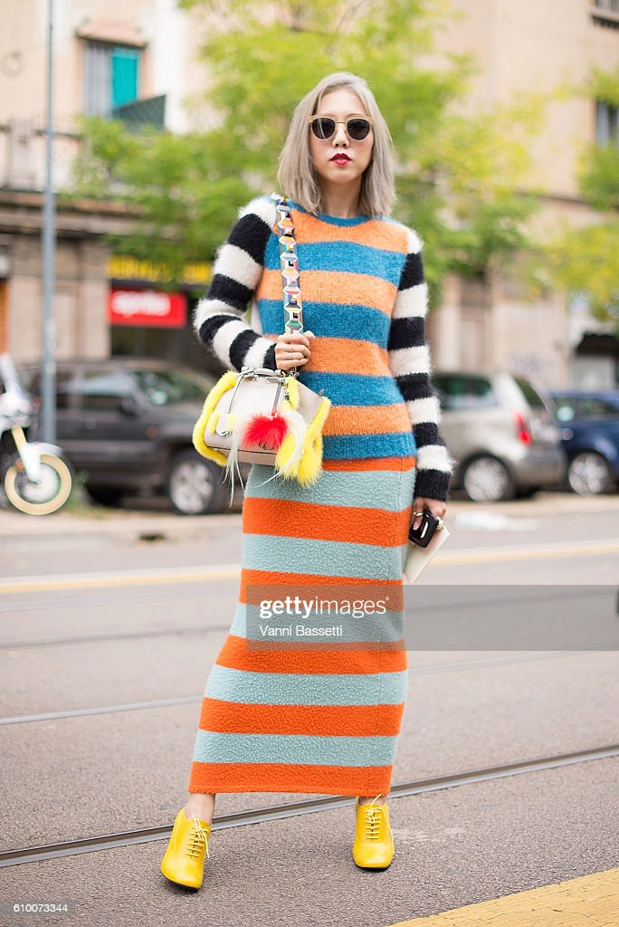 Fay poses wearing a Marmara dress and Fendi bag after the Fendi show during Milan Fashion Week Spring/Summer 2017 on September 22, 2016 in Milan, Italy.