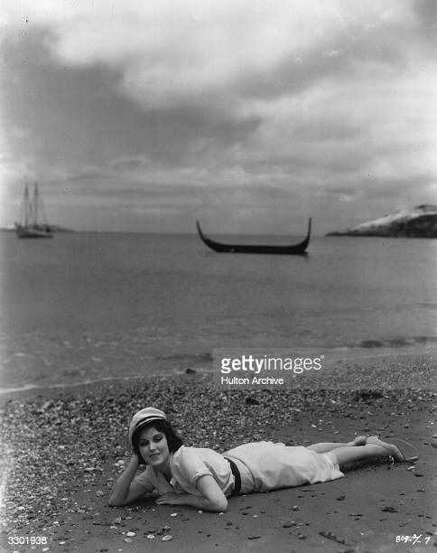 Fay Wray lounges on a beach in the Paramount film 'Sea God' directed by George Abbott