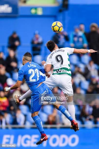 Fayçal Fajr of Getafe CF fights for the ball with Sergi Enrich Ametller of SD Eibar during the La Liga 201718 match between Getafe CF and SD Eibar at...