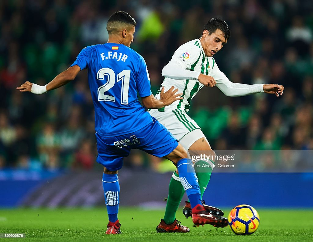Faycal Fajr of Getafe CF competes for the ball with Cristian Tello of...  News Photo - Getty Images