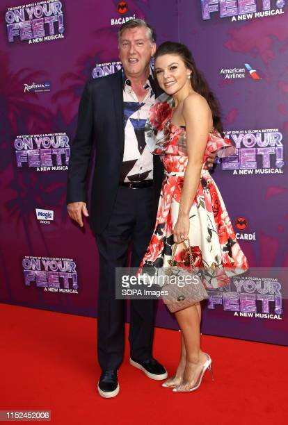 Faye Brookes and Robin Cousins arrive on the red carpet during the On Your Feet Press Night at the London Coliseum St Martin's Lane