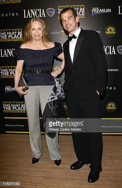 Faye Dunaway and Liam O'Neill attend the 'This Must Be The Place' party hosted by Lancia during the 64th Cannes Film Festival at Plage La Mandala on...