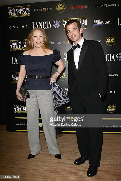 Faye Dunaway and Liam O'Neill attends the 'This Must Be The Place' party hosted by Lancia during the 64th Cannes Film Festival at Plage La Mandala on...