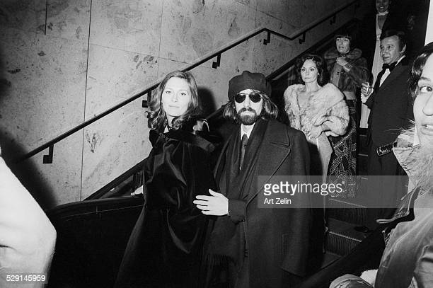 Faye Dunaway and Peter Wolf wearing formal dress leaving a formal event circa 1970 New York