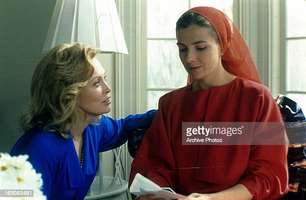 Faye Dunaway approaches Natasha Richardson in a scene from the film 'The Handmaid's Tale' 1990