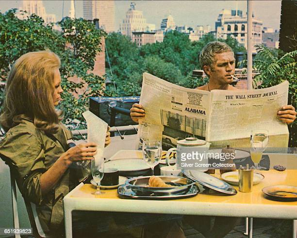 Faye Dunaway as Vicki Anderson and Steve McQueen as Thomas Crown, reading the Wall Street Journal over breakfast in 'The Thomas Crown Affair', 1968.