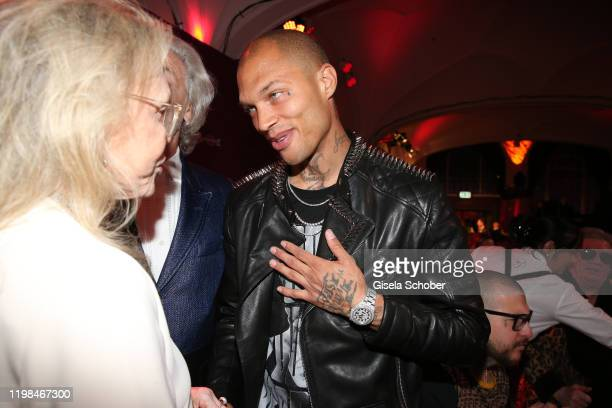 """Faye Dunaway, Hermann Buehlbecker, CEO of Lambertz, and Model Jeremy Meeks during the Lambertz Monday Night 2020 """"Wild Chocolate Party"""" on February..."""
