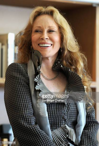 Faye Dunaway receives the Order of Arts and Letters Medal at the Cafe des Palmes during the 64th Cannes Film Festival on May 15 2011 in Cannes France