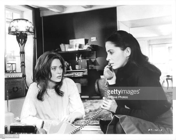 Faye Dunaway watches Barbara Parkins as she makes a phone call in a scene from the film 'The Deadly Trap' 1971