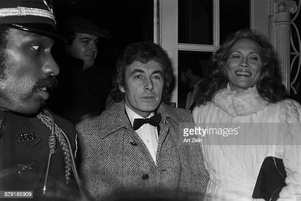Faye Dunaway wearing a white fur with Alan Bates circa 1980 New York