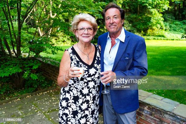 Faye Fortunato and Mathew Fortunato attend A Country House Gathering To Benefit Preservation Long Island on June 28 2019 in Locust Valley New York