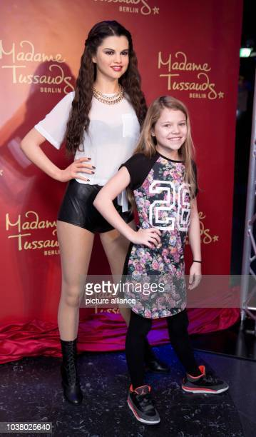 Faye Montana daughter of actress AnneSophie Briest unveils the wax figure of Selena Gomez at Madame Tussauds in Berlin Germany 27 November 2014 Photo...