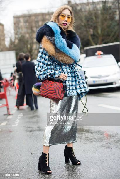 Faye Tsui poses after the Celine show at the tennis Club de Paris during Paris Fashion Week Womenswear FW 17/18 on March 5 2017 in Paris France