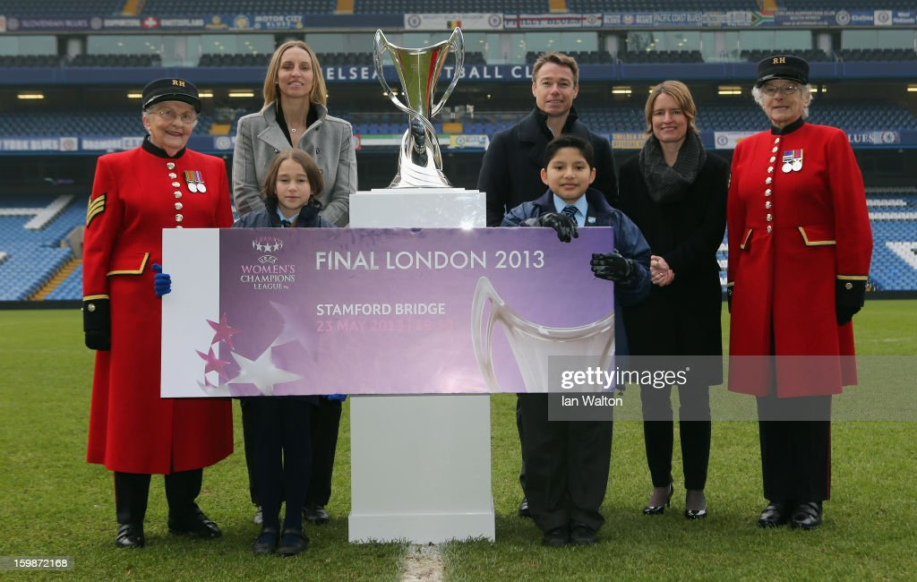 Faye White (2nd L) and Graeme le Saux (C) with Kelly Simmons, Director of The National Game and Women's Football, The Football Association (2ndR) pose with children and Chelsea Pensioners during the ticket launch for the UEFA Women's Champions League Final at Stamford Bridge on January 22, 2013 in London, England.